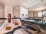 En suite bathroom with steam-shower