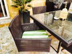 Outsize table with four chairs beside pool area
