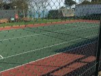 The holiday park tennis court with a sea view