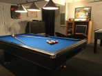 Pool table, 56' TV with PlayStation, Large TV with XBox, electronic darts and football table.