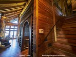 View of the stairs with wood paneling at Sterling Lodge.