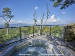 Take in the mountain view while relaxing in the hot tub.