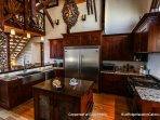 Another view of the kitchen and island at Copperleaf at Eagles Nest.
