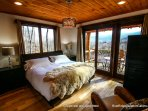 On the main level is the master suite, with king bed, private bath with oversized jetted tub that also features a...