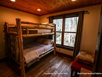 Also located on this level is the bunk room, an excellent adventure for the kids with a unique hand-crafted  bunk bed...