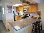 Fully equipped kitchen, with stainless appliances and full sized Washer/Dryer
