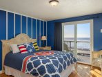 Master bedroom with queen bed, beachview balcony and attached master bath