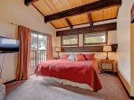 This beautiful master bedroom has a king-size bed, a private patio, and a great view of the mountains!