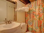 The master bathroom is sweet, and cozy.