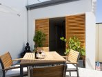 Our rear courtyard is lovely and sunny.