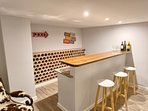 Basement bar with fridge and sink