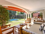 Covered terrace with lounge, outdoor dining and barbecue