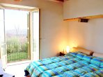 The first elegant double bedroom with views of the surrounding countryside