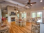 Vaulted ceilings, custom hardwood flooring, large windows with an open space design will provide for a great sense of...