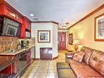 The lovely studio features brand new wood furnishings, leather seating, and a well-equipped kitchenette.