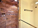The full bathroom features a walk-in shower.