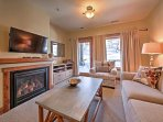 Warm your toes by the fireplace during your stay at this 2-bedroom, 2-bath vacation rental condo in Whitefish!