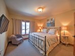 You'll find a king-sized bed in the master bedroom.