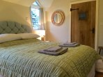 Main bedroom with kingsize bed, ensuite shower and toilet