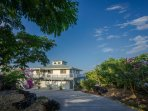 Driveway to luxury home with ocean view and pool