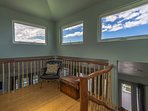 Upstairs cupola or loft area, open up all these windows and let the trade winds flow!