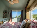 2nd bedroom with a queen sized mattress and ocean views
