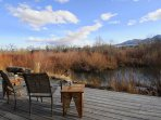 The home's deck overlooks a beaver dammed creek.  Take a cast!