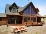 Charming log home with great decks, hot tub, and wide open spaces.