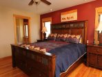 The master bedroom on the main floor has a beautiful king size bed, a private bath with a large shower, a walk-in...