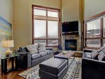 Living Area with large windows - Features comfy leather furniture, HD TV & entertainment center, gas fireplace...