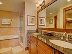 Guest Bathroom 2  - Features deep soaking tub.
