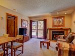 Living & Dining Area - Features a HDTV, gas fireplace & stunning views from inside & outside the living area.