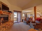 Beautiful Living Area - Features a stone fireplace and HD TV.