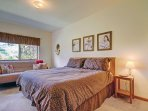Spacious Master Suite - Master Bedroom features a king bed and a futon for additional seating or sleeping.  Bedroom...