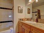 Master Bathroom - Full bathroom with tub and shower.