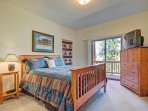 Guest Bedroom - Features TV and private deck.
