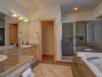 Large Master Bathroom - Features deep soaking jetted tub, walk in shower & dual sinks.