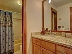 Updated master bathroom - Full bathroom with shower and tub combo.  Also features a steam shower.