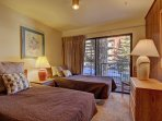 Guest Bedroom - Two twin beds and easy access to guest bathroom.