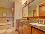 Master Suite Private Bathroom - features double sink, deep soaking bathtub & walk in shower.