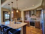 Gourmet Kitchen with Breakfast Bar - High end stainless steal appliances.