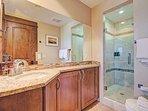 Master Suite 1 Bathroom  - En-suite bathroom features walk in shower and double sinks.