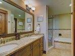 En-suite bathroom - Features deep soaking tub and walk in shower.
