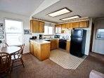 Upper level fully equipped kitchen with all appliances, dining area for 4, I-Pod dock/CD player, door to upper deck and...
