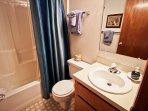 Lower level hall bathroom with a tub/shower combo