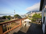 Upper ocean facing deck with a patio table and chairs, gas BBQ and spectacular ocean/mountain views