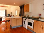 KItchen with Oven, Fridge, Washer/Dryer, Microwave, table and four chairs in breakfast area