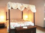 Beautiful & comfortable four-poster bed of the master bedroom