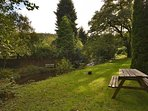 The charming river running through the garden, where guests can enjoy fishing