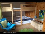 Unique solid wooden bunk bed measures 3x2 meters! 8 people can easily sleep here.